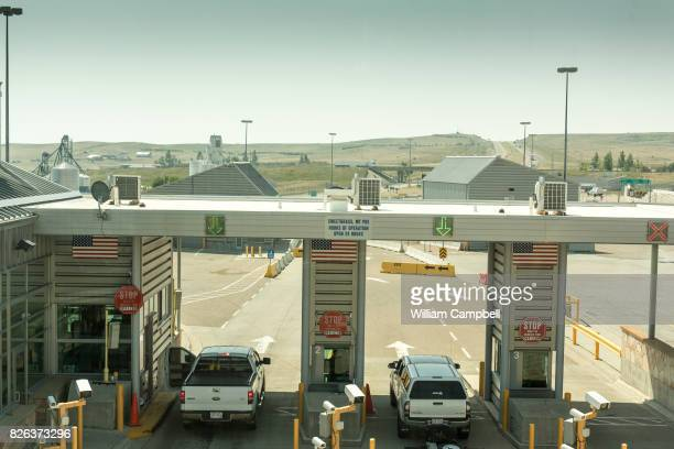 Trucks and cars entering the USA from Canada at the Customs and Border Protection Sweetgrass border crossing on Interstate 15 August 1 2017 in...