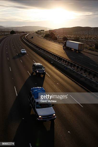 Trucks and cars travel the Interstate 10 freeway on January 17 2010 near of Palm Springs California The San Andreas earthquake fault crosses all...