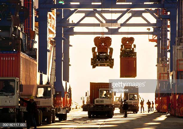 Trucks and gantry in shipping terminal (Digital Enhancement)