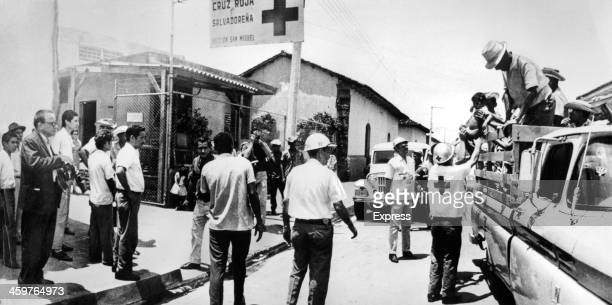 "Trucks and jeeps are brought into action to uplift the persons displaced by the ""Football War"" between Honduras and El Salvador. July 29,1969."
