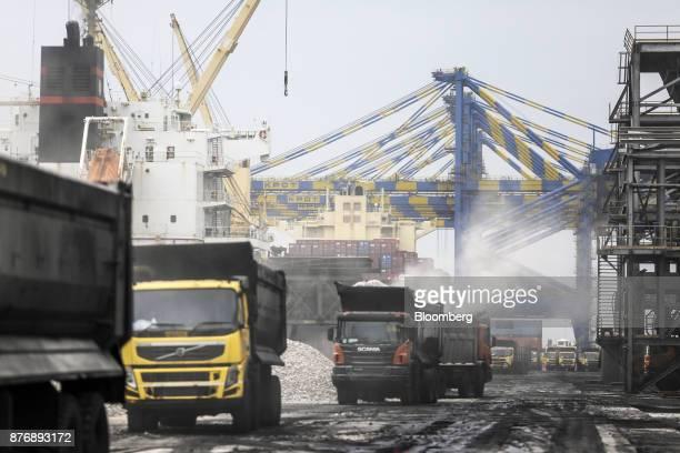 Trucks are loaded with limestone at Krishnapatnam Port in Krishnapatnam Andhra Pradesh India on Friday Aug 11 2017 Growth in gross domestic product...