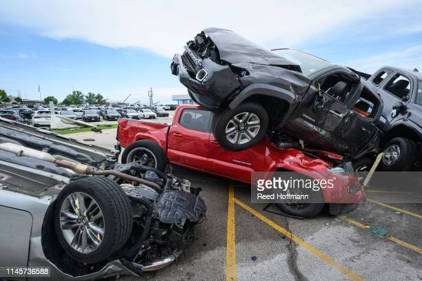 Trucks are piled on top of each other at Riley Auto Group on May 23 2019 in Jefferson City Missouri after a tornado struck there A series of powerful...