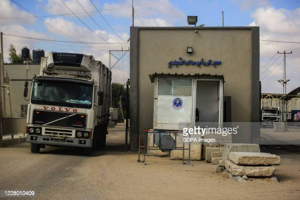 Trucks are seen leaving the gate of the Kerem Shalom crossing in Rafah, in the southern Gaza Strip.