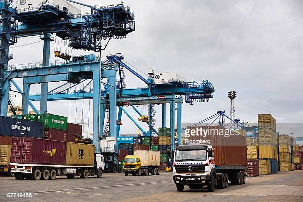 Trucks are seen moving shipping containers for storage and onward shipment on the dockside at Mombasa port managed by the Kenya Ports Authority a...