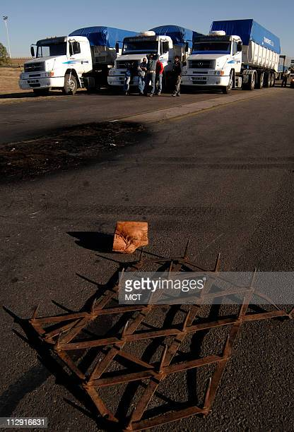 Trucks are stopped in a blockade by farmers and truck drivers in Bragado Buenos Aires province Argentina June 13 2008 With thousands of protesters...