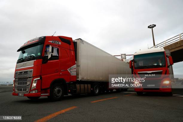 Trucks arrive at the harbour of Calais, northern France, after crossing from Britain on January 1 on the day that the Brexit transition period ends...