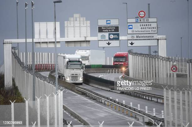 Trucks arrive via the Channel Tunnel at the port of Calais on December 25 after drivers underwent Covid-19 tests in England, where they were held...