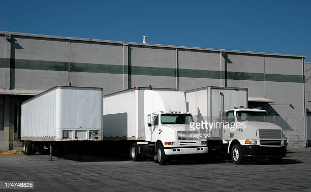 trucks at the loading docks - loading dock stock pictures, royalty-free photos & images