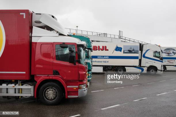 Trucks await cargo loading during a fish auction at the port of Den Helder Netherlands on Friday Aug 4 2017 Prime Minister Theresa May will pull...