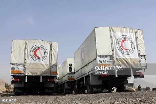 TOPSHOT Trucks belonging to the International Committee of the Red Cross are seen parked on March 8 at the alWafideen checkpoint on the outskirts of...