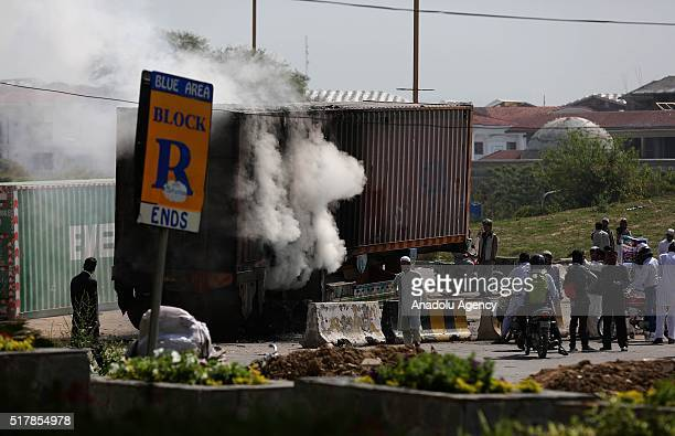 Trucks, burned during a protest staged by supporters against the execution of Mumtaz Qadri, former police bodyguard who shot dead Punjab's governor...