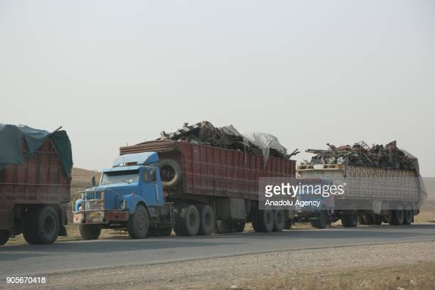 Trucks carry metal scraps to recycling facilities in Erbil which were gathered from the wreckages of collapsed buildings after 9 months long anti...