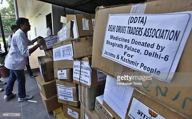Trucks carrying relief material for Jammu and Kashmir flood victims at Delhi BJP Office on September 19 2014 in New Delhi India A team of doctors...