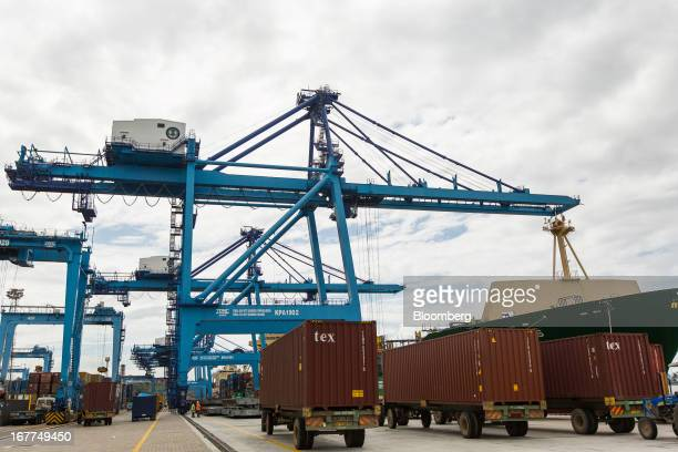 Trucks carrying shipping containers wait to be unloaded by cranes on the dockside of Mombasa port managed by the Kenya Ports Authority a staterun...