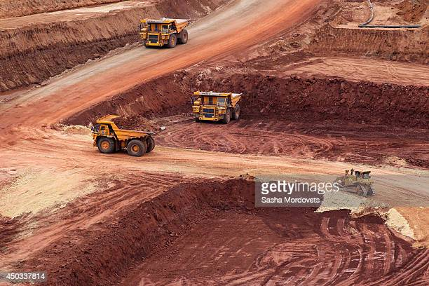 Trucks drive at the Grib deposit diamond mine also known as Verkhotina that is owned by Lukoil June 9 2014 in Mezen district 130 km northeast of...