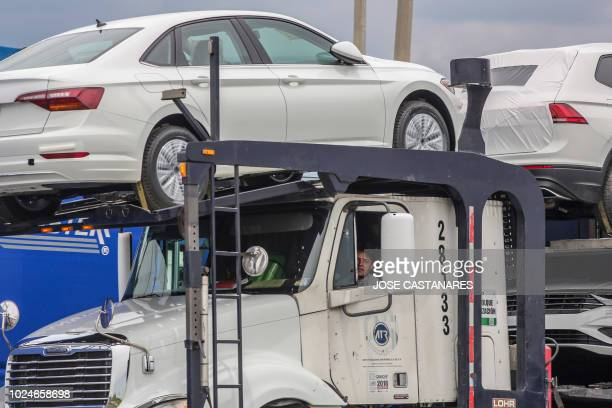 Trucks drive near the Volkswagen plant in Puebla Mexico on August 27 2018 Mexican Presidentelect Andres Manuel Lopez Obrador's advisers on Monday...