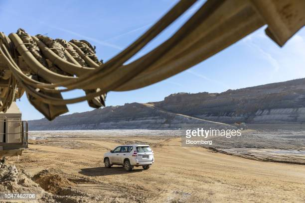 Trucks drive on the terrain at the open pit lignite mine operated by RWE AG in Hambach Germany on Friday Oct 5 2018 The world must invest $24...