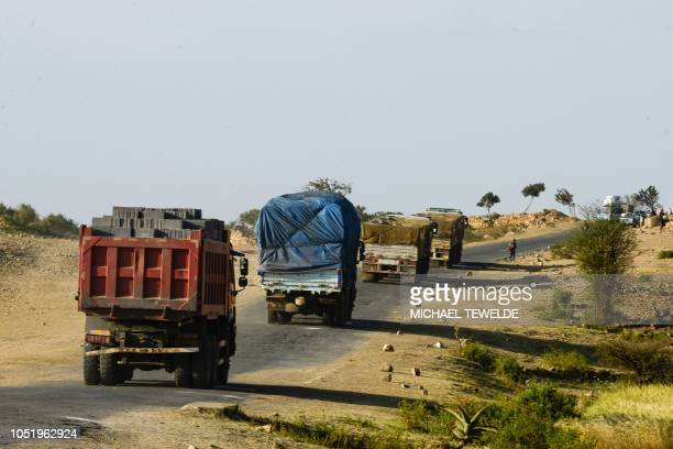 Trucks drive through road on the Ethiopian side of the EthiopiaEritrea border on October 3 2018 The whirlwind peace process between Ethiopia and...