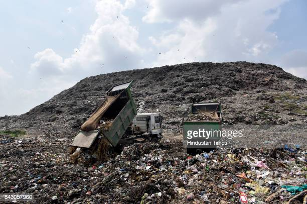 Trucks dumping garbage at Ghazipur landfill site on September 5 2017 in New Delhi India Having failed to find a place for disposing the garbage in...