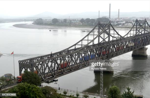 Trucks from North Korea cross a bridge on the border with China in this photo taken from Dandong in China's Liaoning Province in September 2016...