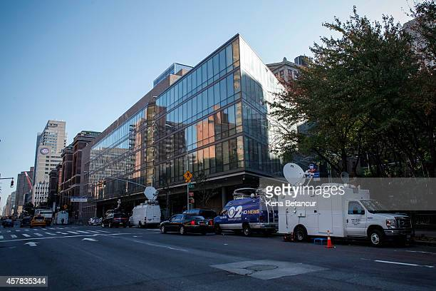 Trucks from the media sit in front of Bellevue Hospital where Dr Craig Spencer who was diagnosed with the Ebola disease remains in quarantine on...