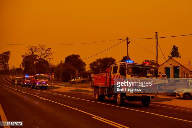 Trucks gather in front of the RFS station on January 04 2020 in Bodalla Australia A state of emergency has been declared across NSW with dangerous...