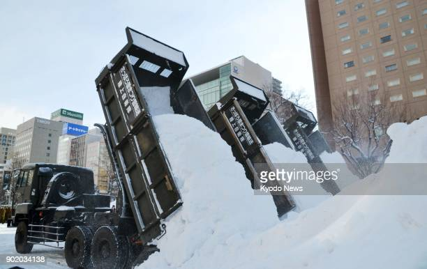 Trucks haul snow for the Feb. 5-12 Sapporo Snow Festival at Odori Park in Sapporo, Hokkaido, on Jan. 7, 2018. The festival will feature more than 200...