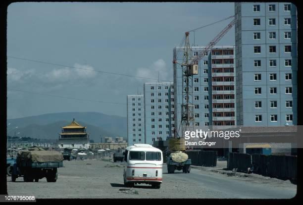 Trucks in Lot Beside Apartment Construction Mongolia