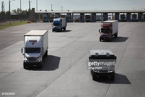 Trucks including an armored car pass through US customs on October 17 2016 in Laredo Texas South Texas customs agents processed $166 billion in...