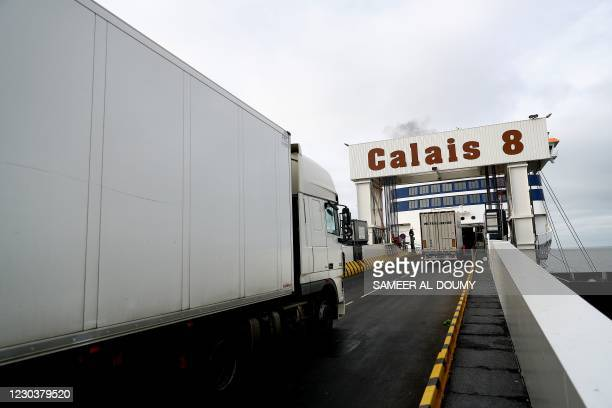 Trucks leave to Britain from the harbour of Calais, northern France on January 1 on the day that the Brexit transition period ends and Britain leaves...