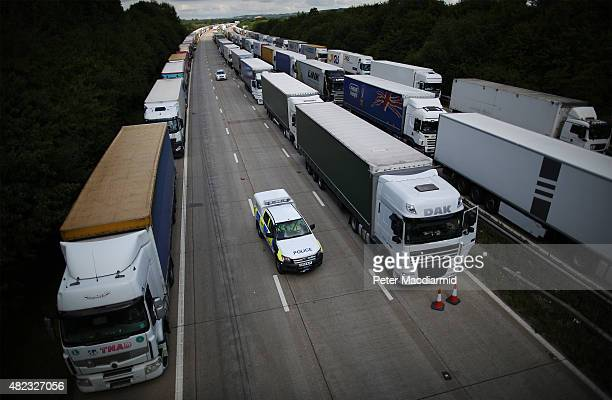 Trucks line up on the M20 during Operation Stack on July 30 2015 near Ashford England Operation stack allows freight vehicles to park on the motorway...