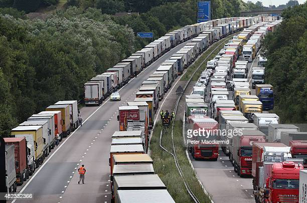 Trucks line up on the M20 during Operation Stack on July 30 2015 near Ashford England Operation stack remains in place on the M20 coastbound between...