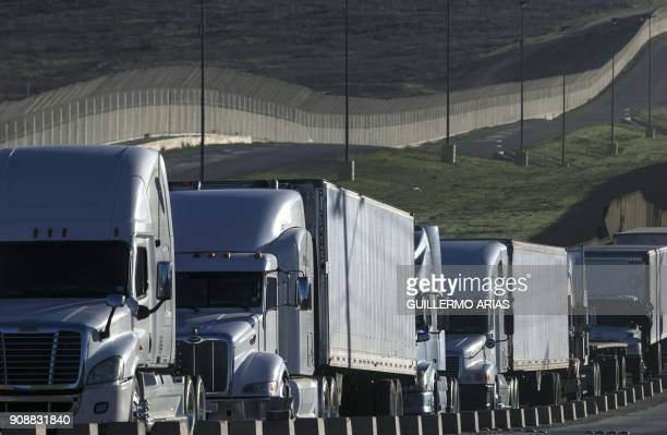 Trucks line up to cross the border with the United States at Otay Mesa Commercial Port of Entry in Tijuana Mexico on January 22 2018 Negotiators from...