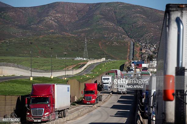 Trucks line up to cross to the United States near the Otay Commercial port of entry on the Mexican side of the USMexico border on January 25 on the...