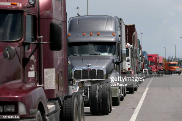 Trucks line up to enter Port Everglades on July 30, 2014 in Fort Lauderdale, Florida. The Gross Domestic Product in the 2nd quarter of 2014 rose 4...