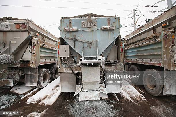 Trucks loaded road salt sit at a Streets and Sanitation yard as the city braces for another winter storm on February 4, 2014 in Chicago, Illinois....