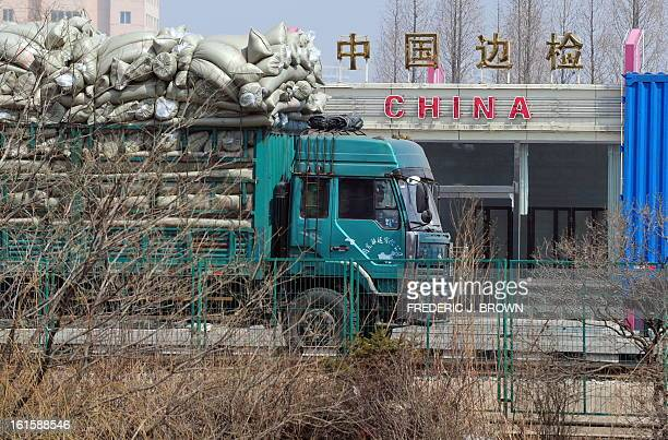 Trucks loaded with cargo pass the last Chinese checkpoint as it crosses the SinoKorean friendship bridge delivering goods from Dandong in northeast...