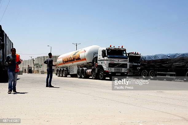 Trucks loaded with food and fuel supplies cross into the Palestinian city of Rafah through the Kerem Shalom crossing between Israel and the southern...