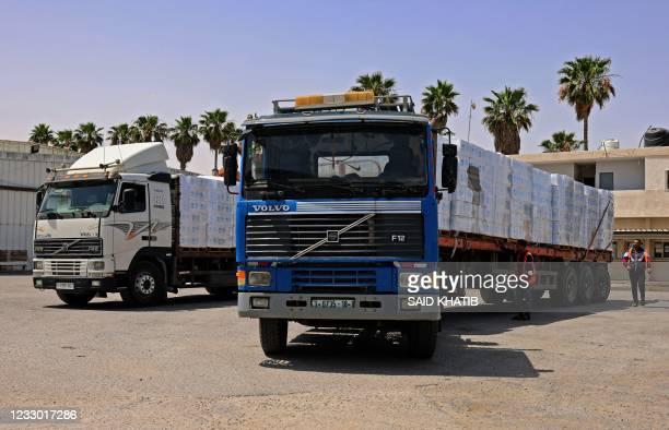 Trucks loaded with humanitarian aid, pass into Rafah in the southern Gaza Strip, through the Kerem Shalom crossing, the main passage point for goods...