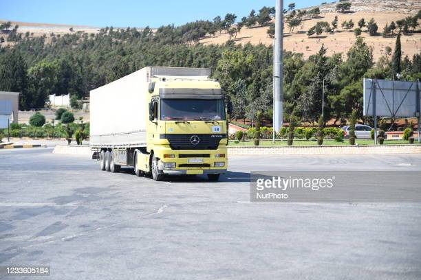 Trucks Loaded With Humanitarian Aid Provided By The United Nations World Food Program Enter Northern Syria Through Bab Al-Hawa Crossing on June 22,...