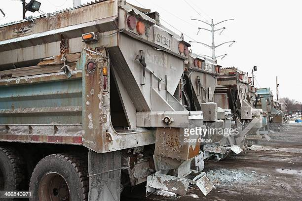 Trucks loaded with road salt sit at a Streets and Sanitation yard as the city braces for another winter storm on February 4 2014 in Chicago Illinois...