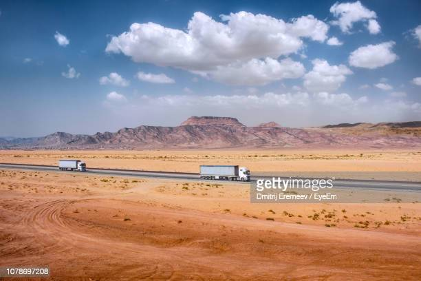 trucks on desert against sky - jordan middle east stock pictures, royalty-free photos & images
