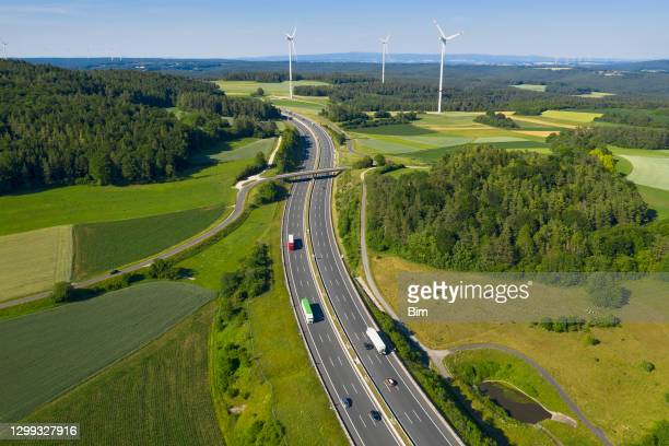 trucks on highway and wind turbines, aerial view - germany stock pictures, royalty-free photos & images