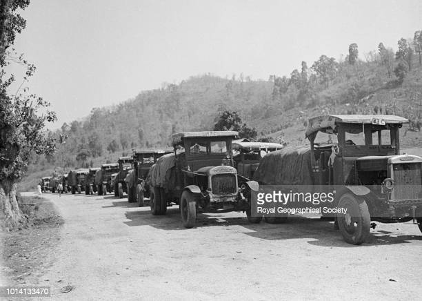Trucks on Shillong Road From a box labelled 'Assam Plains' Accompanying text 'Trucks waiting to pass through the control gate on the Shillong Road Up...