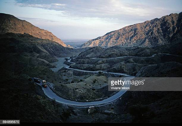 Trucks on the Khyber Pass road from Pakistan to the border of Afghanistan | Location Khyber valley Pass NW Frontier Pakistan