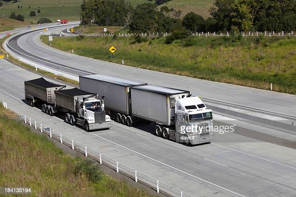 trucks overtaking - moving past stock pictures, royalty-free photos & images