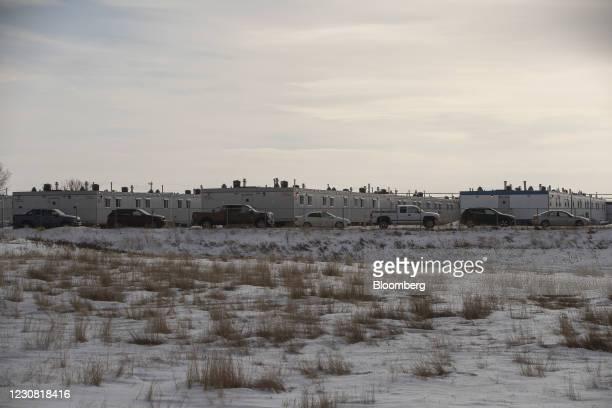 Trucks parked at a work camp for the Keystone XL pipeline in Oyen, Alberta, Canada, on Tuesday, Jan. 26, 2021. U.S. President Joe Biden revokedthe...