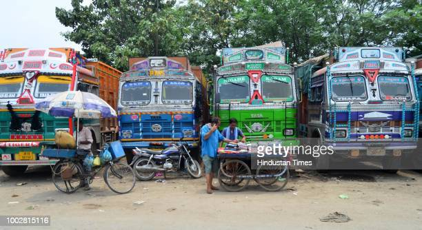 Trucks are seen parked at sector 26 during a strike called by the transporters on July 20 2018 in Chandigarh India