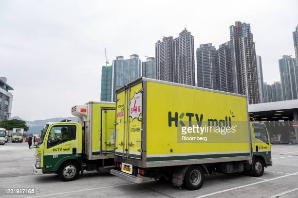 Trucks parked in the loading area outside the fulfillment center at the Hong Kong Television Network Ltd. Headquarters in Hong Kong, China, on...