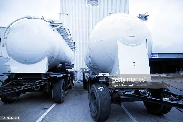 trucks parked outside organic tofu production factory - sigrid gombert fotografías e imágenes de stock